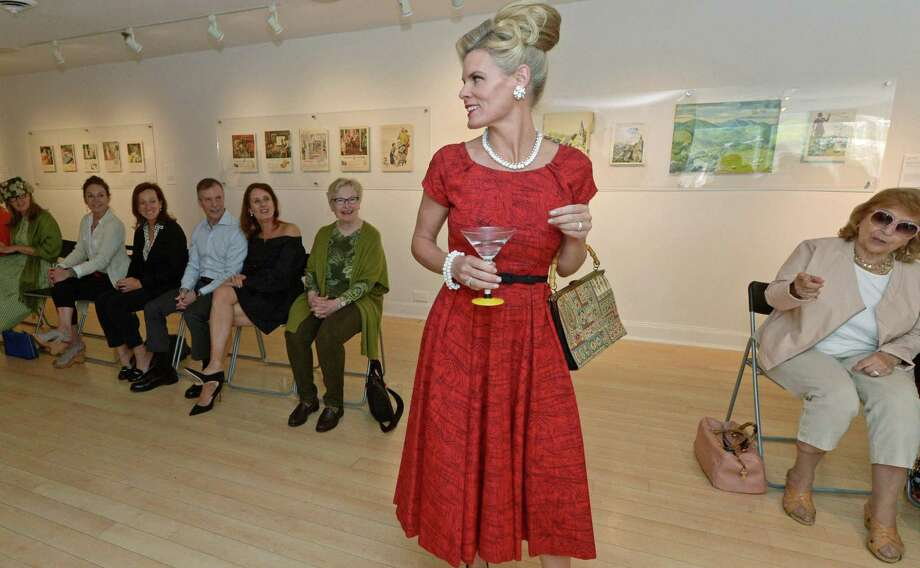 Deborah Murtaugh, center, helps model the classic styles of the 1950s and early 1960s during a vintage fashion show at the Westport Arts Center April 27. The fashion show was in advance of the Mad Men-themed WAC 2017 Gala: Martini Madness to be held at at the Fairfield County Hunt Club on May 20. Photo: Erik Trautmann / Hearst Connecticut Media / Norwalk Hour