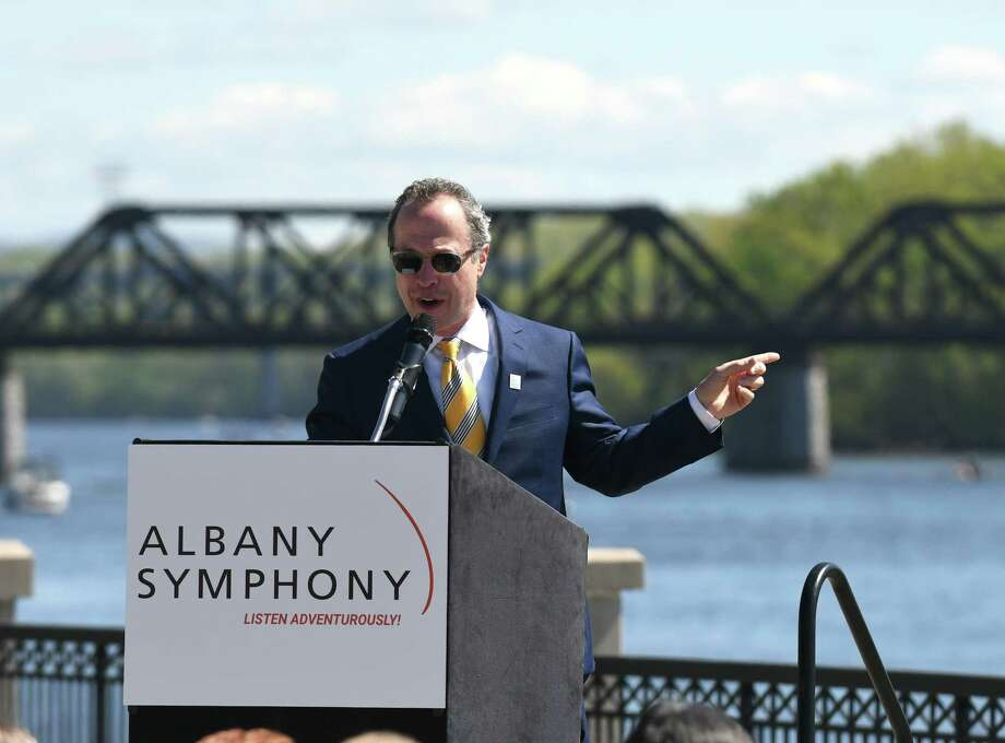 """Albany Symphony conductor David Alan Miller speaks during a press conference to announce a seven-stop Erie canal concert performance by the symphony called """"Water Music,"""" on Friday morning, May, 12, 2017, at Jennings Landing in Albany, N.Y. The series will run from July 2-8. (Will Waldron/Times Union) Photo: Will Waldron / 20040491A"""