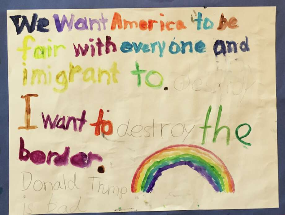 ">>Click through these photos to see what Houston children wanted to say to Donald Trump.""Trump! The Art Show"" curators Randall Kallinen and John Paul Hartman received dozens of immigrant-related art pieces by anonymous Texas school children. Photo: Randall L. Kallinen"