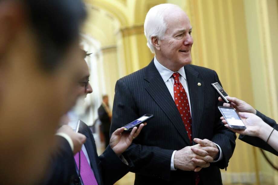 Senate Majority Whip John Cornyn of Texas, talks with reporters about President Trump's decision to fire FBI Director James Comey, on Capitol Hill in Washington, Wednesday, May 10, 2017. (AP Photo/Jacquelyn Martin) Photo: Jacquelyn Martin, STF / Associated Press / Copyright 2017 The Associated Press. All rights reserved.