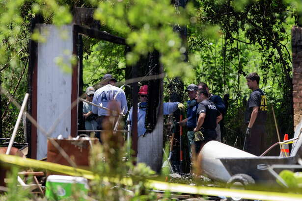 Authorities investigate the scene of a house fire that left three children dead and several more injured on Johnson Road Friday, May 12, 2017, in Tamina, Texas.