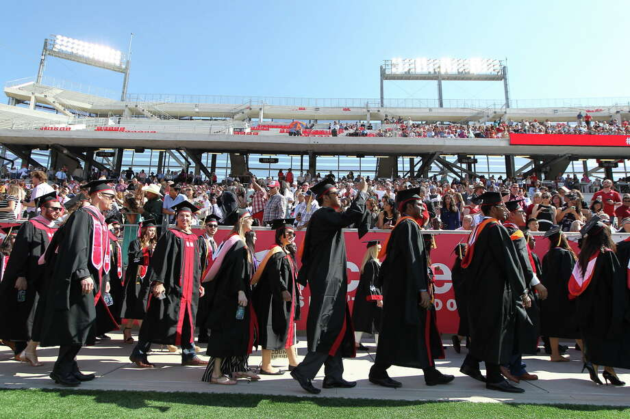 Graduates enter TDECU Stadium for a University of Houston-wide commencement  Friday, May 12, 2017, in Houston.Click through to compare the cost of college from 18 years ago and today. Photo: Steve Gonzales, Houston Chronicle / © 2017 Houston Chronicle