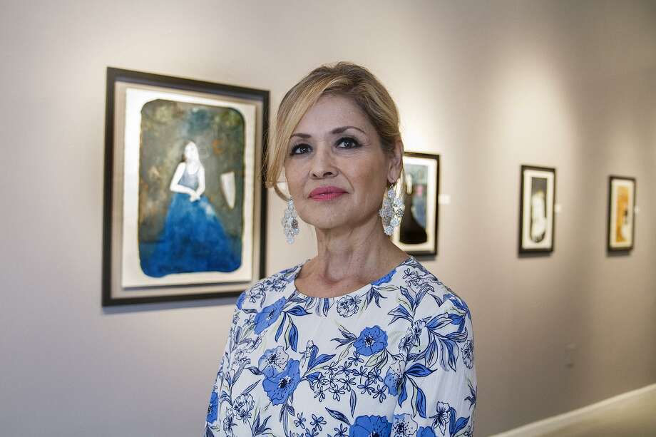 """Laura Mijangos at AnArte Gallery, Wednesday, May 10, 2017, where you can find her work as part of """"Echoes, a two-person show at the gallery. This set of collages incorporate prints by her father, artist Alberto Mijangos, that she discovered after his death. Photo: Alma E. Hernandez /Alma E. Hernandez / For The San Antonio Express News"""
