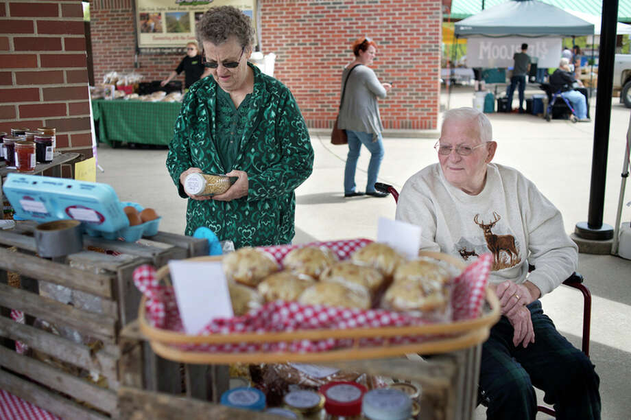 BRITTNEY LOHMILLER | blohmiller@mdn.net Fran Longsdorf, left, and her husband Charlie Longsdorf shop at the Farmer's Market Wednesday afternoon afternoon. Charlie and Fran met at the Farmer's Market and were later married when Fran turned 17and will be celebrating 61 years of marriage May 17. 'He had a holey t-shirt, patched jeans he hadn't shaved but when he later delivered the potatoes to my home, I thought he cleaned up pretty nicely. He was handsome,' Fran said.