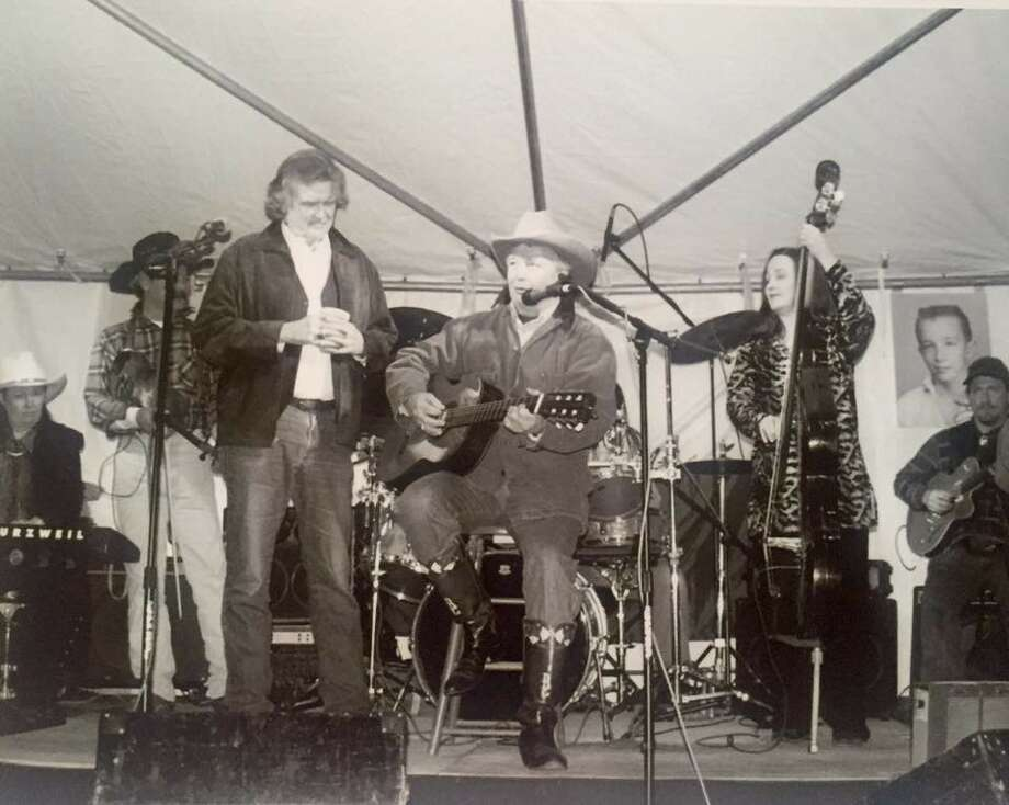 """Guy Clark first wrote songs and performed at clubs in Houston. Right: Attorney Dick DeGuerin performs Clark's """"Madonna and Child ca. 1969"""" at his 60th birthday in February 2001 as Clark looks on. Photo: Courtesy Of Dick DeGuerin"""