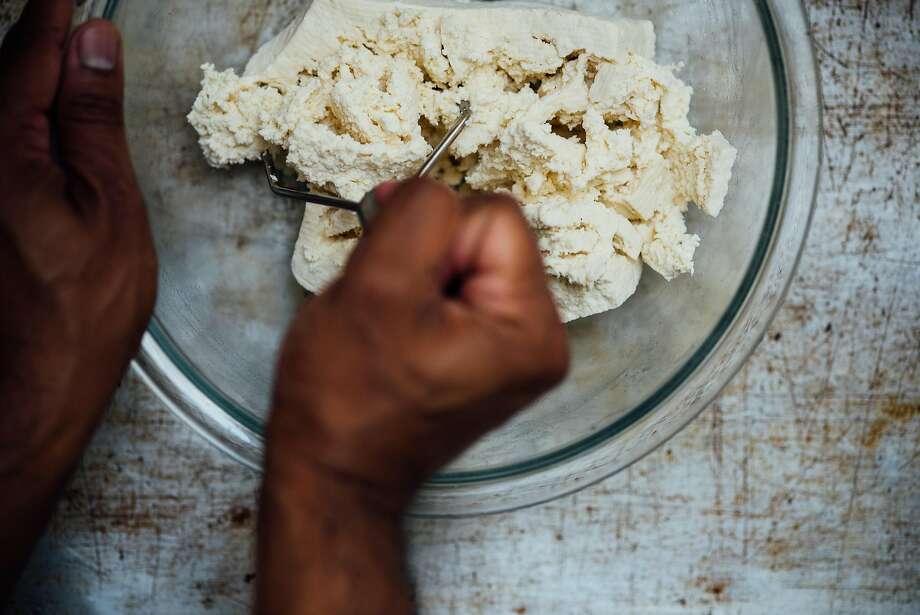 Mashing the tofu. Photo: Nik Sharma