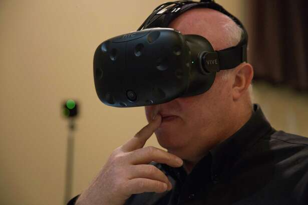 Houston ISD orchestra conductor Brad Smith explores a virtual reality model of the new High School for the Visual and Performing Arts on Friday, May 12, 2017.