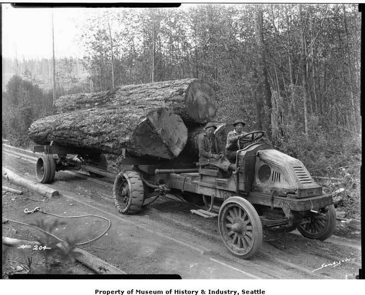 """""""By the late 1920s, many logging companies had started using trucks to haul logs out of the forest and down to the sawmill. This photo was taken in the mid-1920s, somewhere in western Washington. A Kelly-Springfield truck hauls a load of fir logs along a logging road . This photo was taken in the mid-1920s by Bellingham photographer J. Wilbur Sandison and copied a few years later by Webster & Stevens."""" -MOHAI. Photo courtesy MOHAI, PEMCO Webster and Stevens Collection, image number 1983.10.3676.15."""