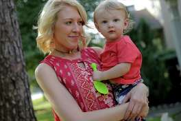 Chelsea Schehr, 24, with her son, Jude, in her Spring, Texas home on Thursday, May 11, 2017, in Spring. The 24-year-old mother has been in the news after being held in Waller County Jail last month on suicide watch while also on her period. She was given no feminine hygiene products, as is Waller and other county's procedure