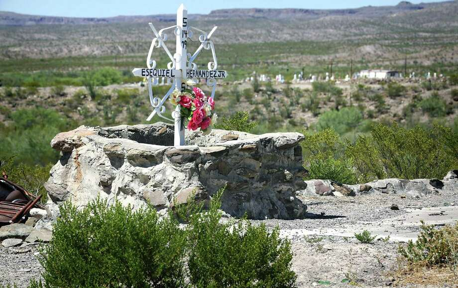 Esequiel Hernandez was herding his family's goats when he was shot and killed by Marines training in the area around Redford, TX, on May 20, 1997. A modest cross marks the spot where he was killed. His grave is just a quarter mile away from the town's cemetery, right. Photo: Bob Owen, Staff / San Antonio Express-News / ©2017 San Antonio Express-News