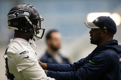 69bd4e2f8 Rookie defensive tackle Malik McDowell is coached by Travis Jones at  Seahawks rookie minicamp at Virginia