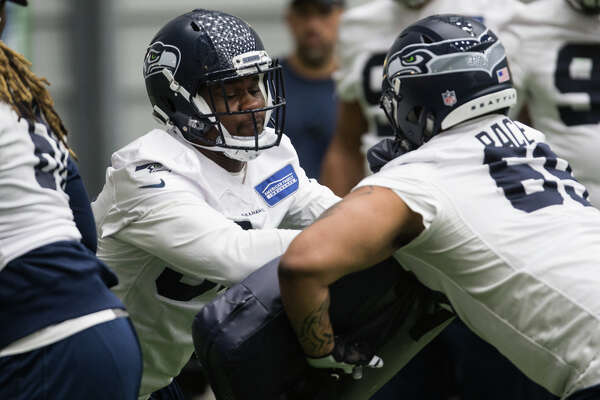 Rookie defensive tackles Malik McDowell and Alex Pace complete a drill at Seahawks rookie minicamp at Virginia Mason Athletic Center in Renton on Friday, May 12, 2017.