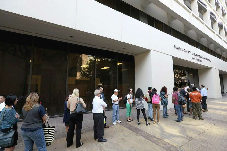 A long line of voters waiting to cast their votes for early voting outside of Harris County Tax Office Wednesday, Oct. 26 in Houston. A ProPublica report revealed shortcomings in the state oversight of the election last year because it failed to properly educate poll officials and voters on changes to the voter ID law. Photo: Yi-Chin Lee /Houston Chronicle / © 2016  Houston Chronicle