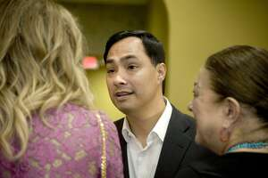 U.S. Rep. Joaquin Castro interacts with attendees at a meet-and-greet event at La Posada Hotel on April 18. He had been mulling a Senate race against Sen. Ted Cruz, who has lost much of his luster, but chose not to run.