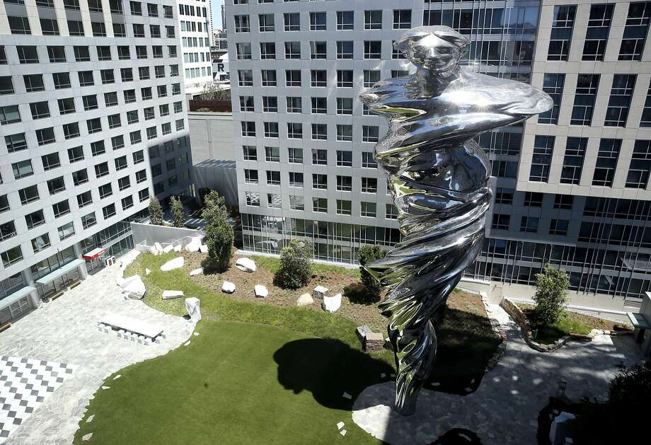 "Above: Artist Lawrence Argent's 92-foot-high stainless steel sculpture ""Venus"" dominates the central courtyard at Trinity Place. Below: Carved marble images of Yvonne and Angelo Sangiacomo. Photo: Paul Chinn, The Chronicle"