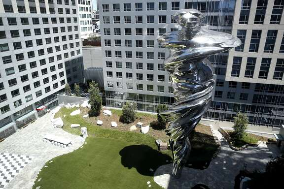 """Artist Lawrence Argent's 92-foot high stainless steel sculpture """"Venus"""" is seen from an apartment on the 10th floor of Trinity Place at 8th and Mission streets in San Francisco, Calif. on Friday, May 12, 2017. Venus is the dominating centerpiece of the central piazza, which will be open to public access daily."""