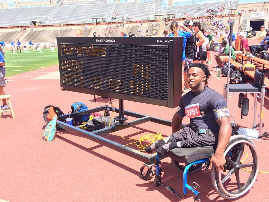 Woodville's Carrington Marendes earned a medal in boys shot put wheelchair competition on Friday. Photo: The Enterprise/Danny Shapiro