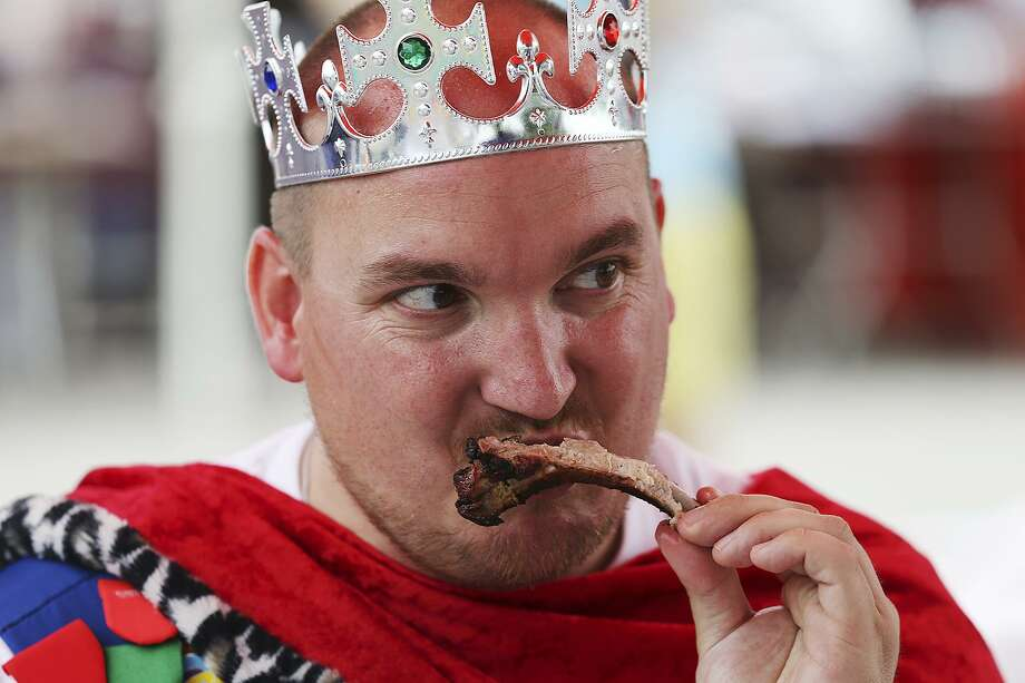 David Uminski judges ribs during the Cultural Fest and Rib Cook-Off at St. Philip's College last year. Uminski was recognized this month as the 2017 Certified Tourism Ambassador of the Year. Photo: Express-News File Photo / © 2015 San Antonio Express-News