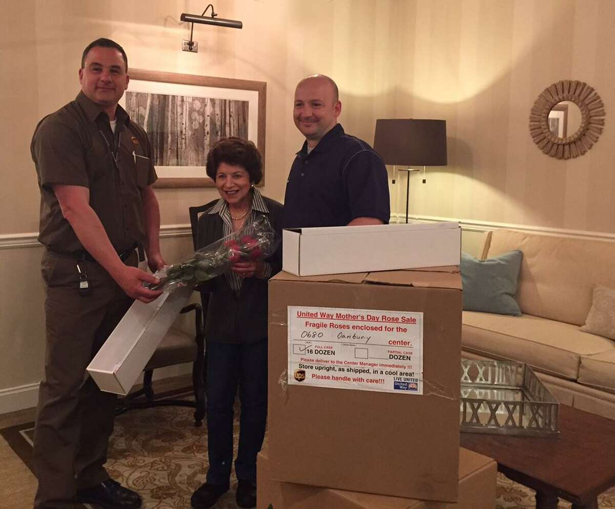 UPS driver Robert Reed Maplewood resident Nancy Merlino and UPS Business Manager Jordan Deller.
