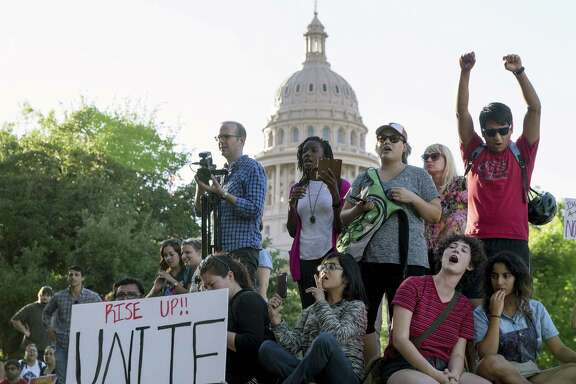 Protesters against the Senate Bill 4 sanctuary cities ban rally May 1 outside the Texas Department of Insurance building where Republican Gov. Greg Abbott has an office in Austin. The ACLU is representing clients in federal court challenging the measure.