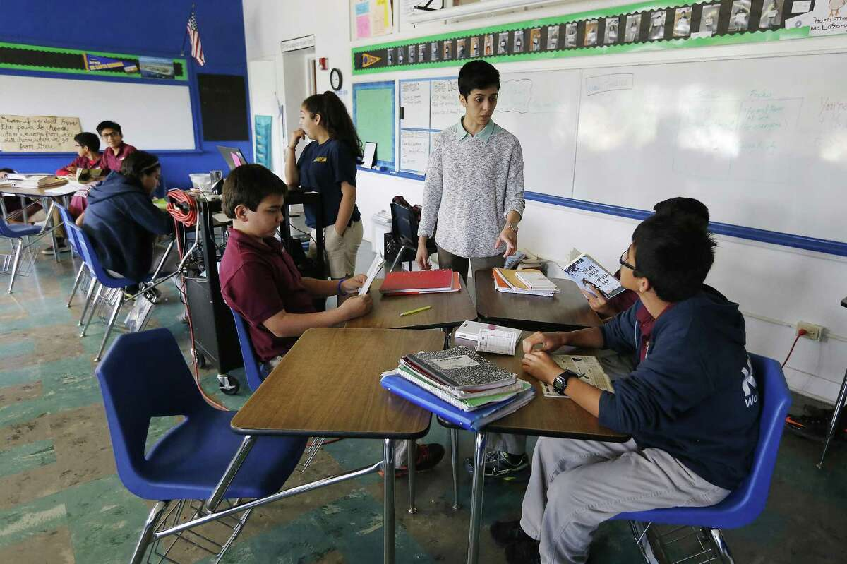 One-hundred percent of the KIPP University Prep Class of 2014, 2015, 2016, and 2017 earned college acceptance. Here, KIPP Aspire seventh-grade reading teacher Krystal Lazaro talks with her students in class in 2015.