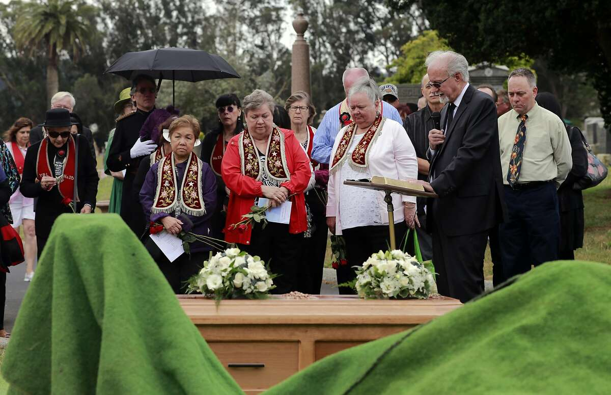 Allan E. Musterer, (right) delivers a message during the reburial of Edith Howard Cook, the girl from the 1800's whose body and coffin were found under the floor of an San Francisco home. The ceremony taking place at the Greenlawn Memorial Park Cemetery in Colma, California on Sat. June 4, 2016.