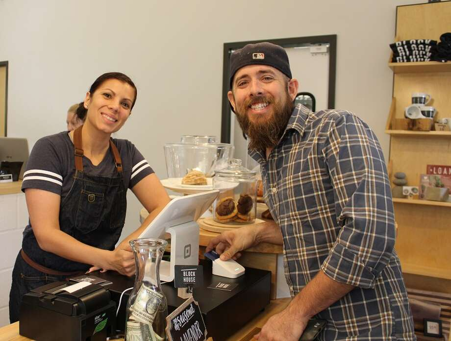 Erica Gutierrez-Culpepper, BlockHouse Coffee & Kitchen, and Zach Lambert of Five Built Design Co. Lambert created the new coffee shop's wood accents. Photo: Central Fort Bend Chamber