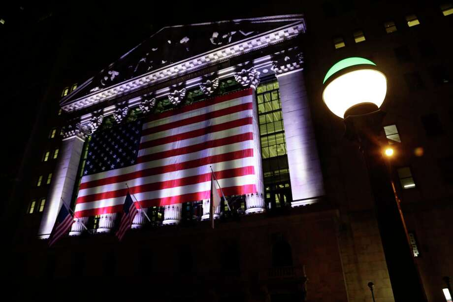 FILE - In this Friday, Feb. 17, 2017, file photo, an American flag hangs on the front of the New York Stock Exchange on an evening, in New York. Stocks are opening lower on Wall Street, Friday, May 12, 2017, led by declines in industrial companies and banks. (AP Photo/Peter Morgan, File) Photo: Peter Morgan, STF / Copyright 2017 The Associated Press. All rights reserved.