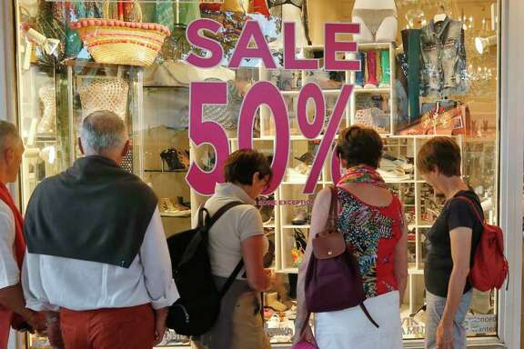 Shoppers check out a store in Miami Beach. Retail sales increased 0.4 percent in April from March.