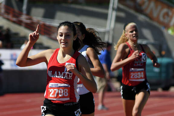 Houston Lamar senior Julia Heymach (2708) crosses the finish line ahead of Abilene's Ashton Endsley (2207) and Lewisville Marcus's Quinn Owen (2834) to win the gold medal in the Class 6A Girls 3,200-Meter Run at the UIL Track & Field State Championships at Mike A. Myers Stadium on the campus of the University of Texas at Austin in Austin on Friday, May 12, 2017. (Photo by Jerry Baker/Freelance)