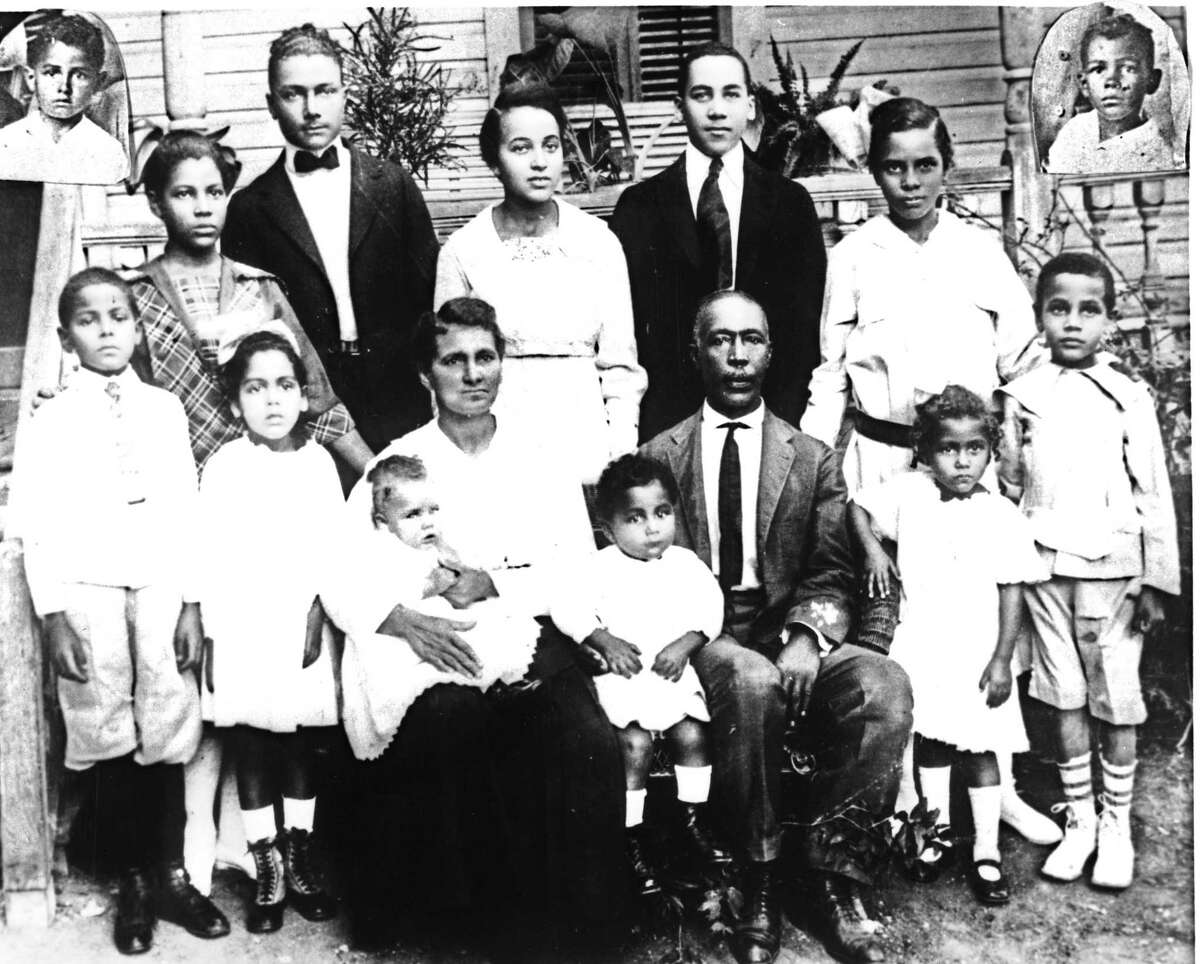 A large Sutton family photo taken in 1917 outside their home at 430 N. Cherry St. includes (front row, left to right) Garlington Jerome