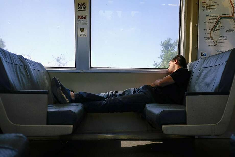 BART hasn't been enforcing its ordinance prohibiting passengers from taking up more than one seat. Photo: Michael Short, Special To The Chronicle