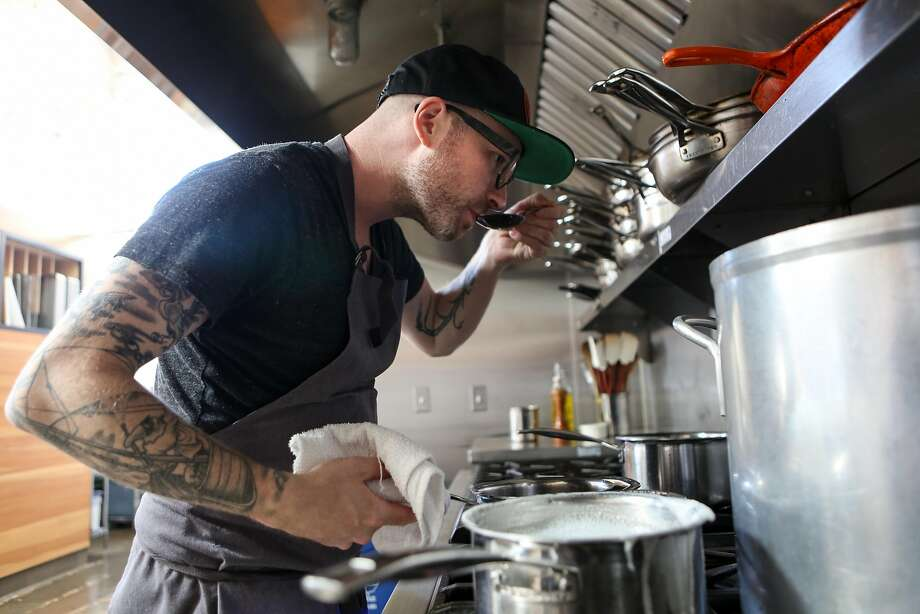 Anthony Strong tastes a dish. Photo: Amy Osborne, Special To The Chronicle