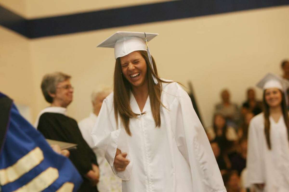 Kaila Casey, of Milford, reacts to shouts from the audience at Lauralton Hall commencement exercises in Milford on Sunday, June 6, 2010.