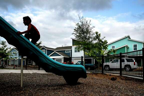 Damian Amya, 6, climbs up a slide while playing tag with his brother at a park in the Avenue Place affordable housing neighborhood Tuesday, April 25, 2017 in Houston. The city has wasted, misspent or lost track of tens of millions of affordable housing dollars over the last decade. ( Michael Ciaglo / Houston Chronicle)