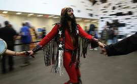 Ivan Rodriguez dances in a circle before a performance by SF Airship, a Jefferson Airplane cover band, to kick off the opening of the Summer of Love exhibit at the de Young Museum in San Francisco, Calif. on Saturday, April 8, 2017.