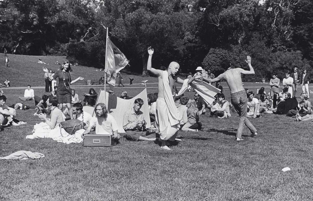 HARE KRISHNAS: Followers of the religious movement were a high-profile part of the spiritual-seeking scene of the Summer of Love. Here they are singing and chanting in Golden Gate Park in 1967.