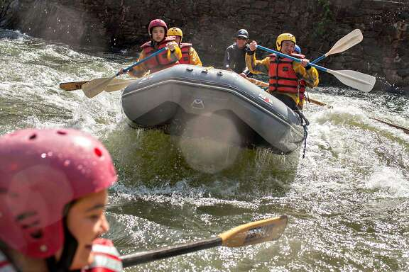 Whitewater rafters with Zephyr Whitewater Rafting hit a wave on the Merced River in El Portal, Calif. Wednesday, May 10, 2017. Conditions for whitewater recreation have improved dramatically because of this years massive snowmelt.