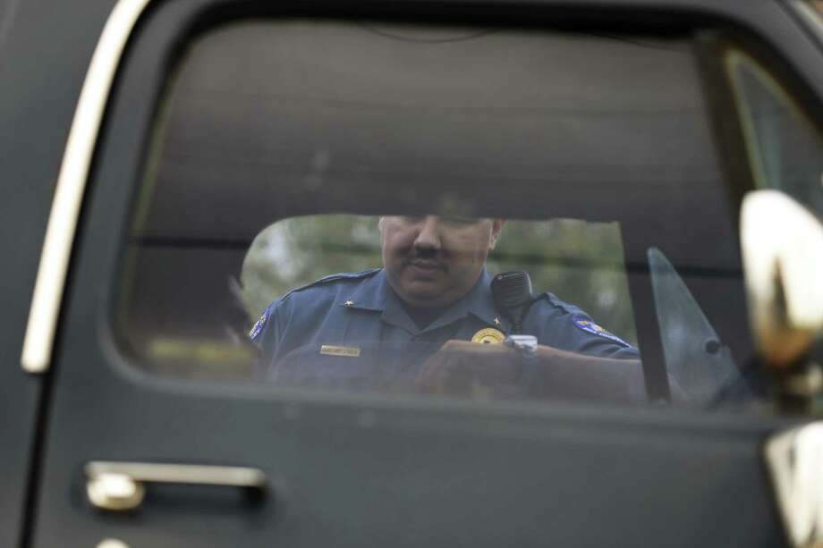 Rio Grande City Assistant Police Chief Joey Solis, 33, talks with a man he pulled over for driving with an expired registration sticker, Thursday, May 11, 2017. Solis said that unless is a serious crime, most department officers rarely asked for the citizenship of people they interact with throughout their shifts. Photo: JERRY LARA / San Antonio Express-News / © 2017 San Antonio Express-News