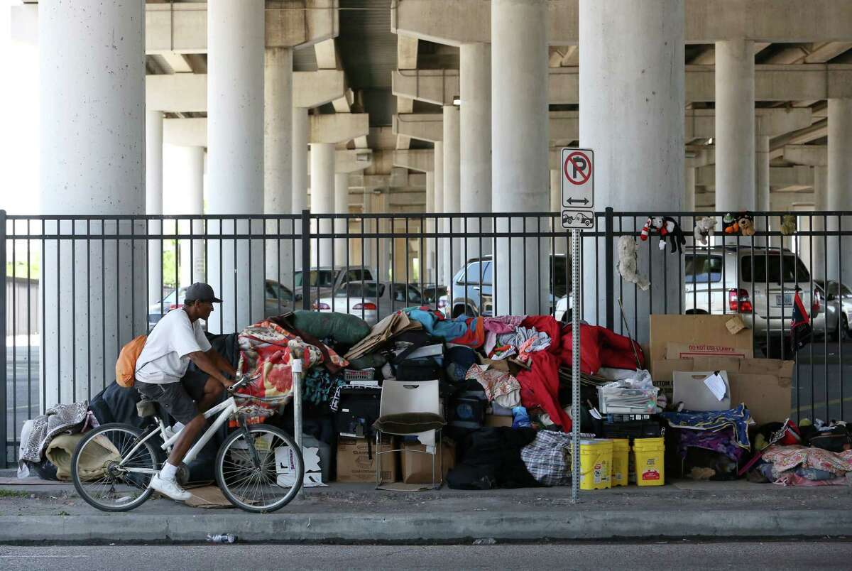 Belongings at U.S. 59 at Congress Ave. Friday, when Houston's ban on encampments went into effect.