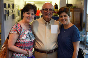 """Julie Abshire, left, and Melissa Wright with father Charles Beaugh during a reception for the Museum of the Gulf Coast's """"Betting, Booze and Brothels"""" exhibit on Friday evening. The exhibit traces the area's history through illegal gambling, speakeasies and brothels.  Photo taken Friday 5/12/17 Ryan Pelham/The Enterprise"""