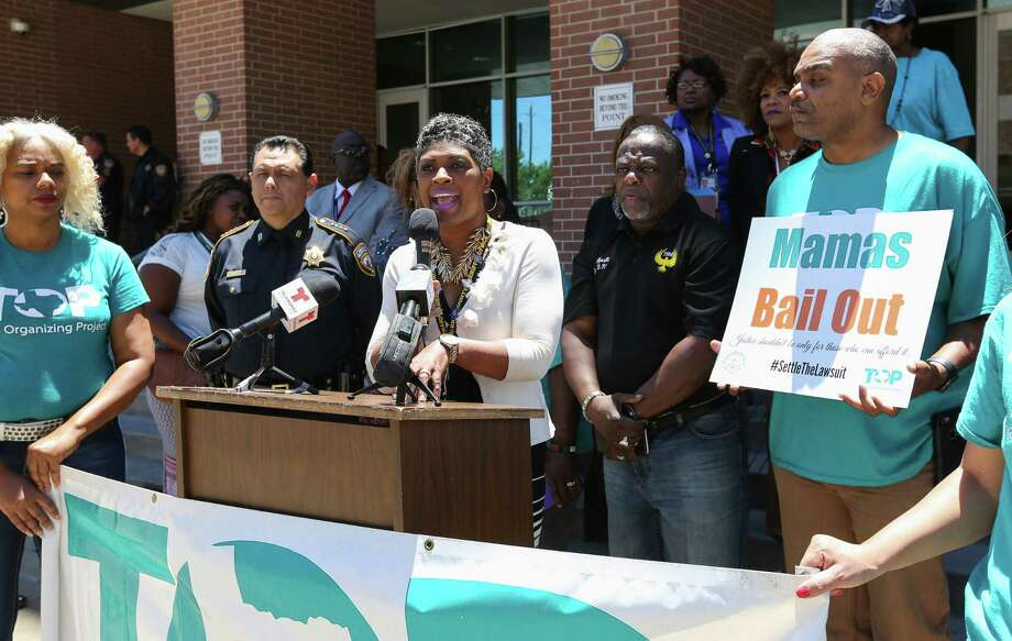 Harris County Sheriff's Director of Re-entry Program Jennifer Herring speaks about efforts to post bail for mothers to be with their families on Mother's Day.  Photo: Yi-Chin Lee, Staff / © 2017  Houston Chronicle