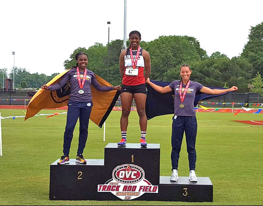 SIUE's Lauren White (middle) celebrates her first-place in the heptathlon on Friday on the Ohio Valley Conference Outdoor Championships in Oxford, Ala.
