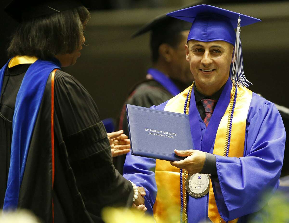 Cesar Mendez, 29, gets his associate's degree Friday during St. Philip's College 137th Commencement Ceremony at Freeman Coliseum.