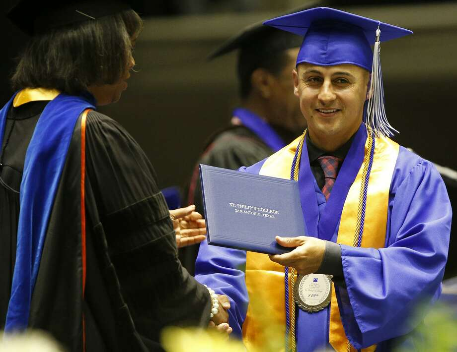 Cesar Mendez, 29, gets his associate's degree Friday during St. Philip's College 137th Commencement Ceremony at Freeman Coliseum. Photo: Edward A. Ornelas /San Antonio Express-News / © 2017 San Antonio Express-News