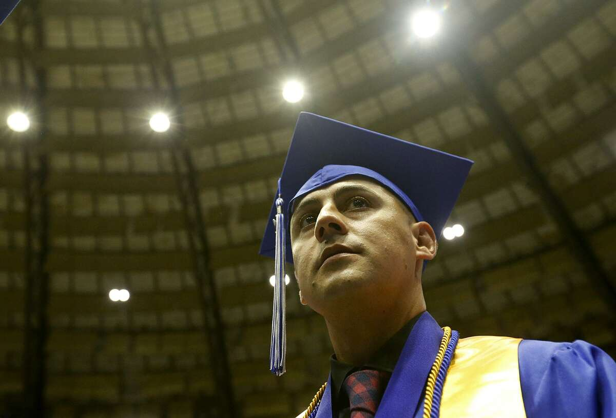 Cesar Mendez waits back stage for the start of St. Philip's College 137th Commencement Ceremony, held Friday at Freeman Coliseum.