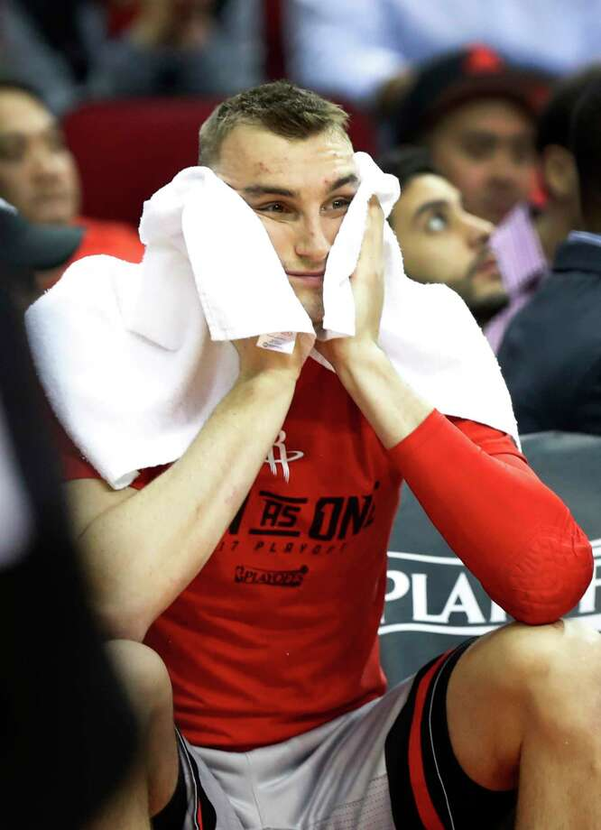 Not only did the Rockets' Sam Dekker have to suffer though the ignominy of Thursday's 39-point loss, but he also injured his ankle during the course of it. Photo: Karen Warren, Staff Photographer / 2017 Houston Chronicle