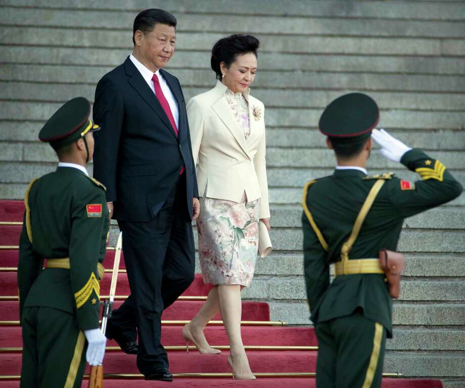"In this May 11, 2017 photo, Chinese President Xi Jinping, center left, and his wife Peng Liyuan arrive for a welcome ceremony for Vietnam's President Tran Dai Quang at the Great Hall of the People in Beijing. China will seek to burnish President Xi Jinping's stature as a world-class statesman at an international gathering centered on his signature foreign policy effort envisioning a future world order in which all roads lead to Beijing. The ""Belt and Road Forum"" opening Sunday, May 14 is the latest in a series of high-profile appearances aimed at projecting Xi's influence on the global stage ahead of a key congress of the ruling Communist Party later this year.  (AP Photo/Mark Schiefelbein) Photo: Mark Schiefelbein, STF / Copyright 2017 The Associated Press. All rights reserved."