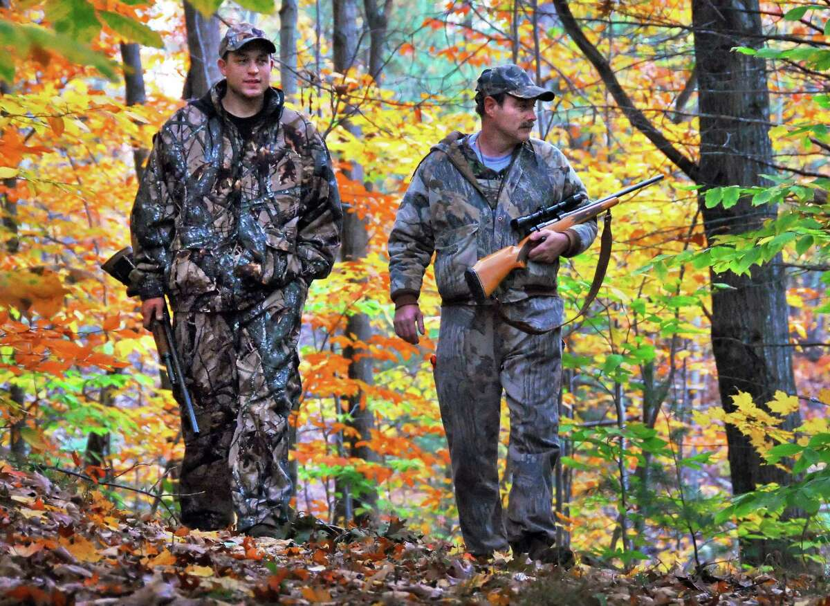 Herbert Spalding, right, and his son Josh Spalding, both of Ballston Spa, deer hunt in Middlegrove Tuesday afternoon Oct. 23, 2007. (John Carl D'Annibale/Times Union archive)
