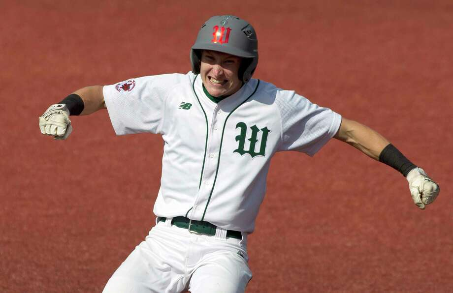 Shane Sirdashney #20 of The Woodlands celebrates after hitting a 2-RBI triple during the fourth inning in Game 1 of a Region II-6A area high school baseball playoff series Friday, May 12, 2017, in Huntsville. Photo: Jason Fochtman, Staff Photographer / © 2017 Houston Chronicle